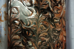 There are a couple of layers that came before this, graduating from light streaks to this dark mass of swirls.
