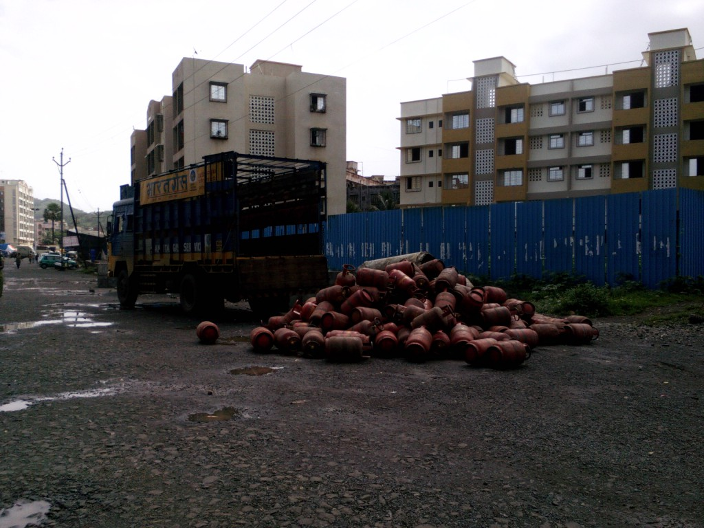 Bharat Gas cylinder heap on the road near the delivery truck