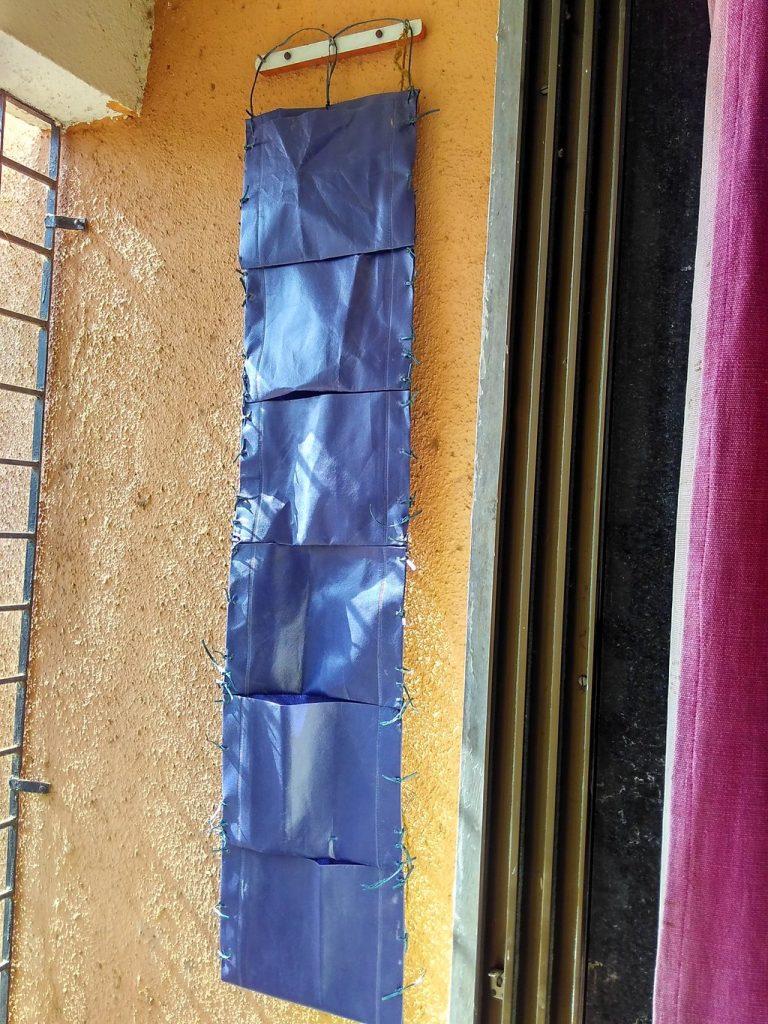 Vertical garden from scraps of tarpaulin like cloth pieces